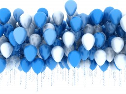 Blue party balloons over white background